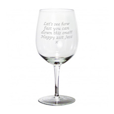 A fantastic gift for anyone who loves wine! This giant wine glass can actually hold an entire bottle of wine and can be engraved with any message up to 70 characters.