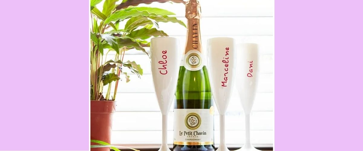 Champagne bottle and 3 personalised wine flutes.