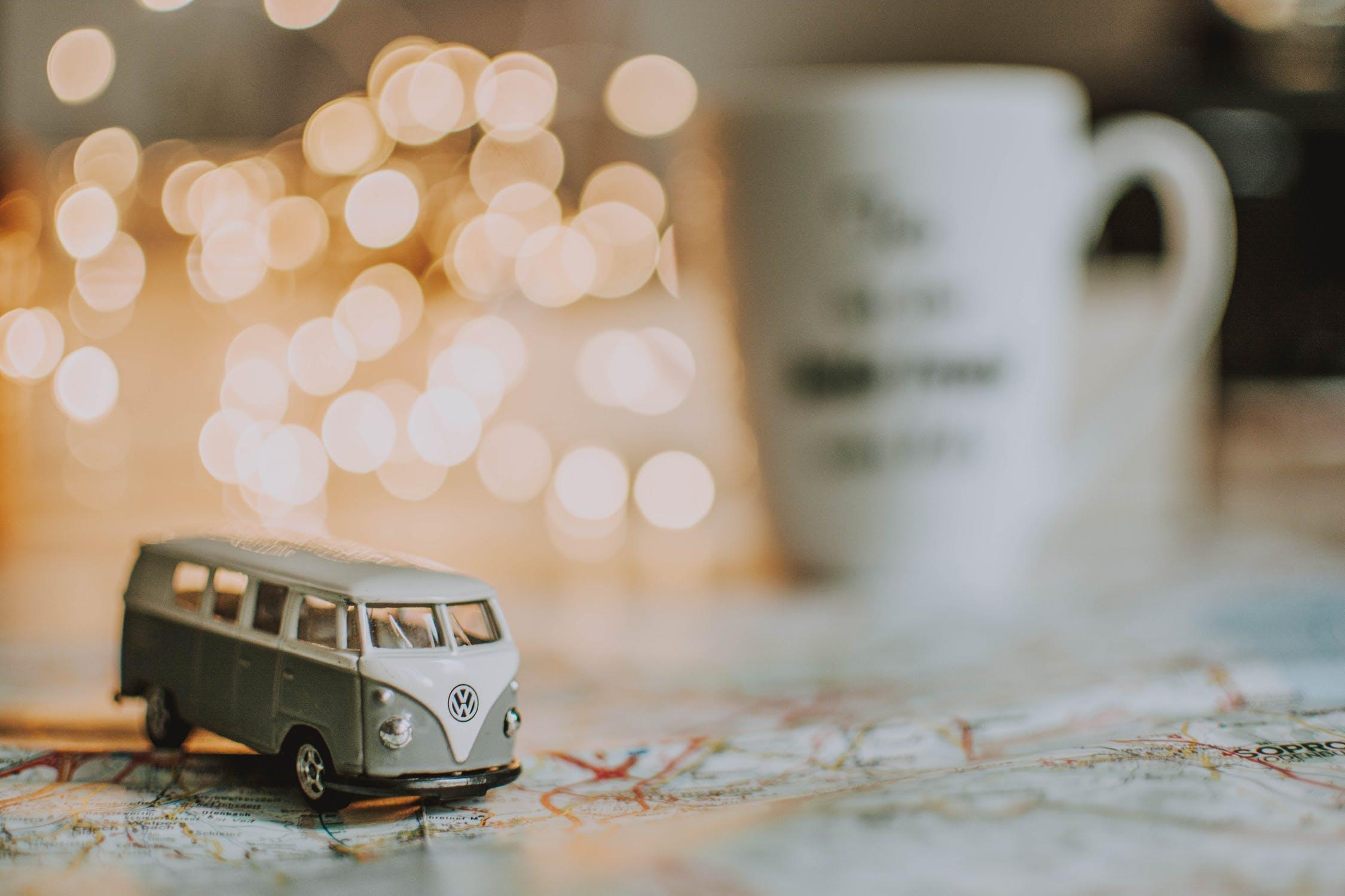 A toy Volkswagen camper van on a table.
